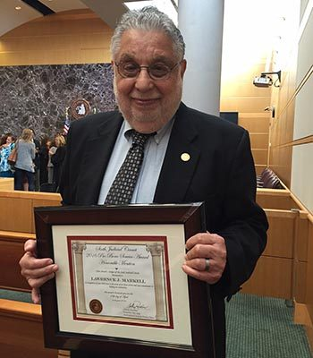 Larry Markell holding certificate