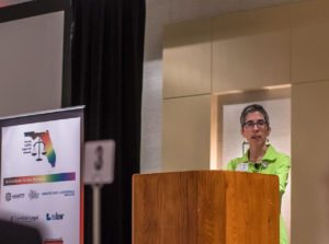 Hayley Gorenberg at a podium at the LGBTQ Summit