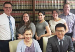 Dade Legal Aid staff attorneys Steve Paulson, Alexandra Mesa, Stephanie Grosman, Evita Féria Laguna and Mark Brown (back row) hosted Cornell Law students Michaela Kamemoto and Weigang Meng during spring break.