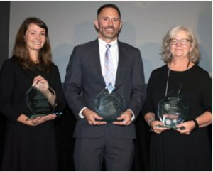 Attorneys Katy DeBriere of JALA, Jeffrey Hearne of Legal Services of Greater Miami, and Kathy Grunewald of Florida Legal Services accept the second runner-up Goldstein Award.